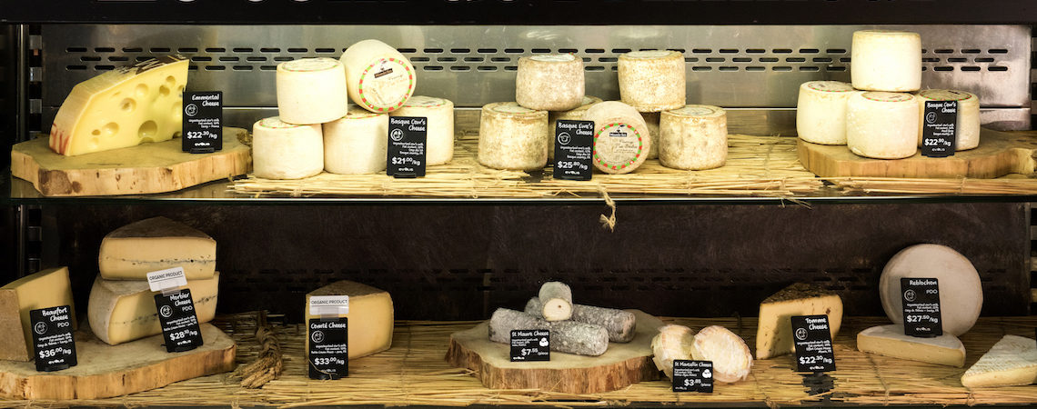 Cheese products displayed with handwritten font price card design